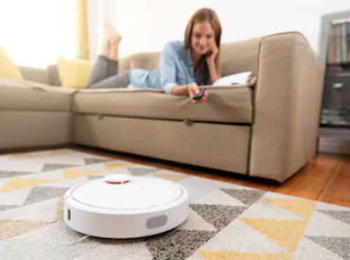girl controlling the robot vacuum